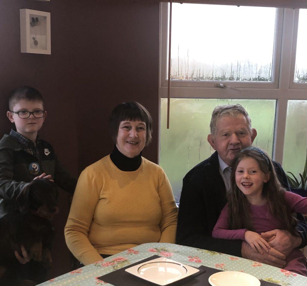 Grandparents and 2 grandchildren in happy times.